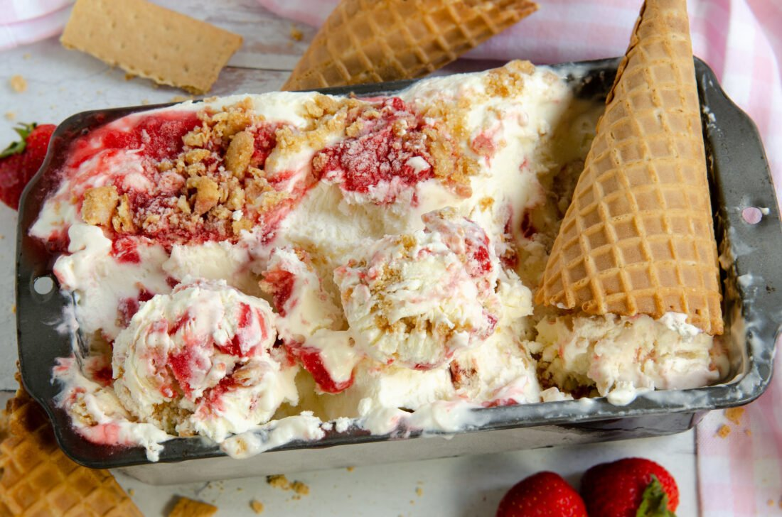 A creamy no-churn ice cream recipe that tastes better than store-bought. This strawberry cheesecake no-churn ice cream is layered with homemade strawberry filling and a buttery gram cracker crust. No ice cream machine is required!